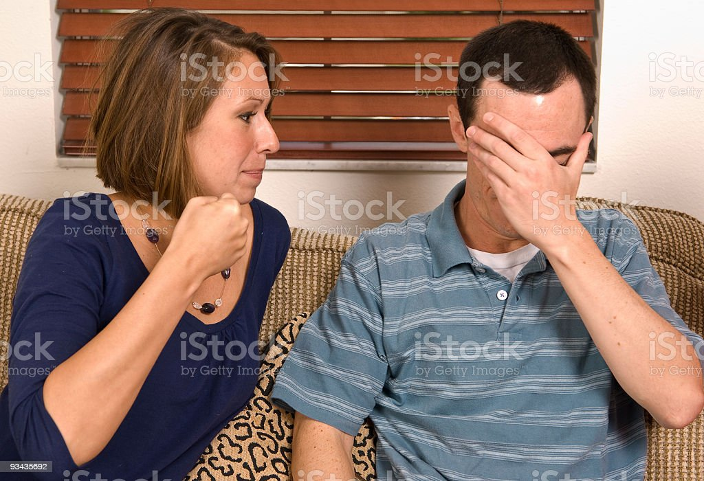 Young adult female about to punch her significant other stock photo