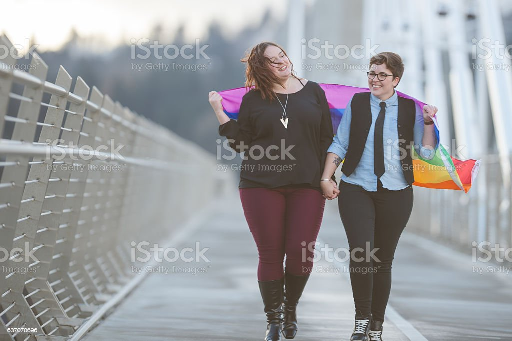 A young adult female couple is out on a walk together stock photo