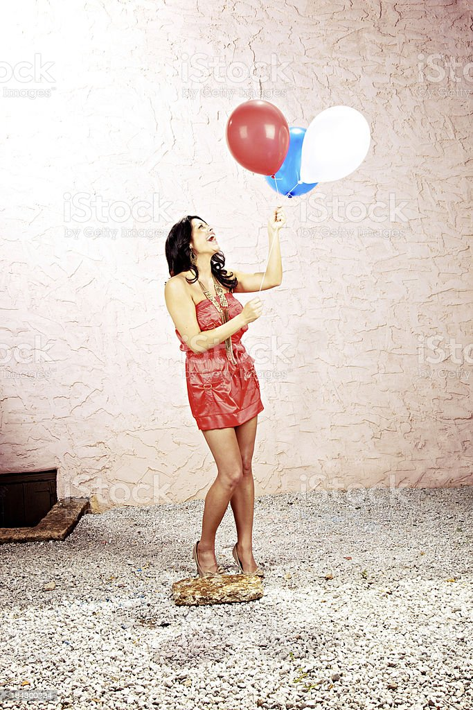 young adult female red white and blue balloons royalty-free stock photo