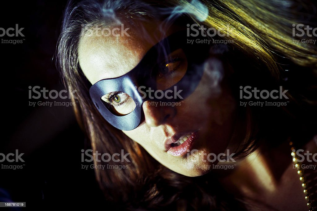 Young adult female wearing a mask royalty-free stock photo