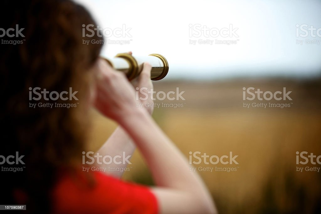 young adult female with brass telescope stock photo