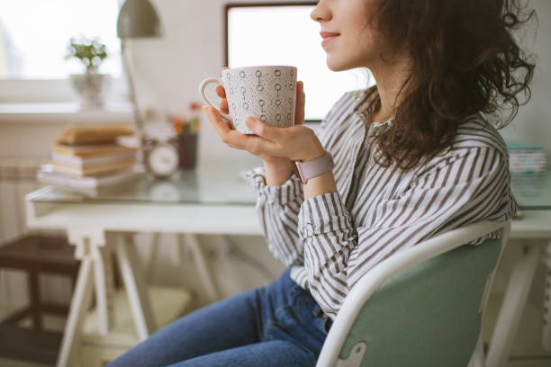Young adult female working at home with coffee break – Foto
