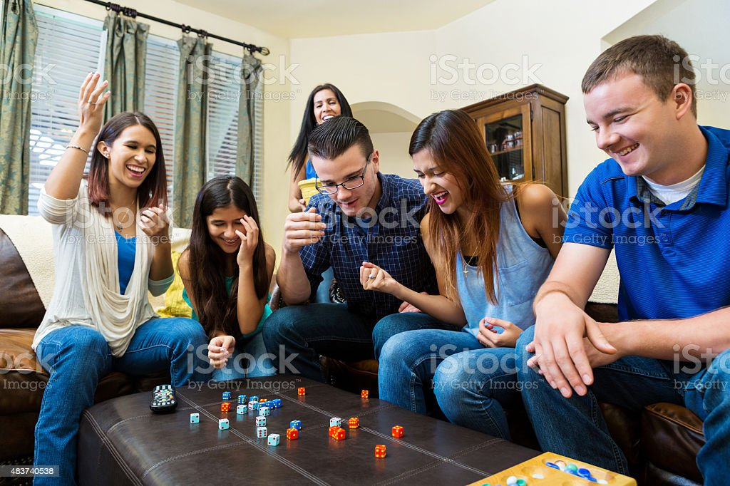 Young adult friends having fun, playing games at home stock photo