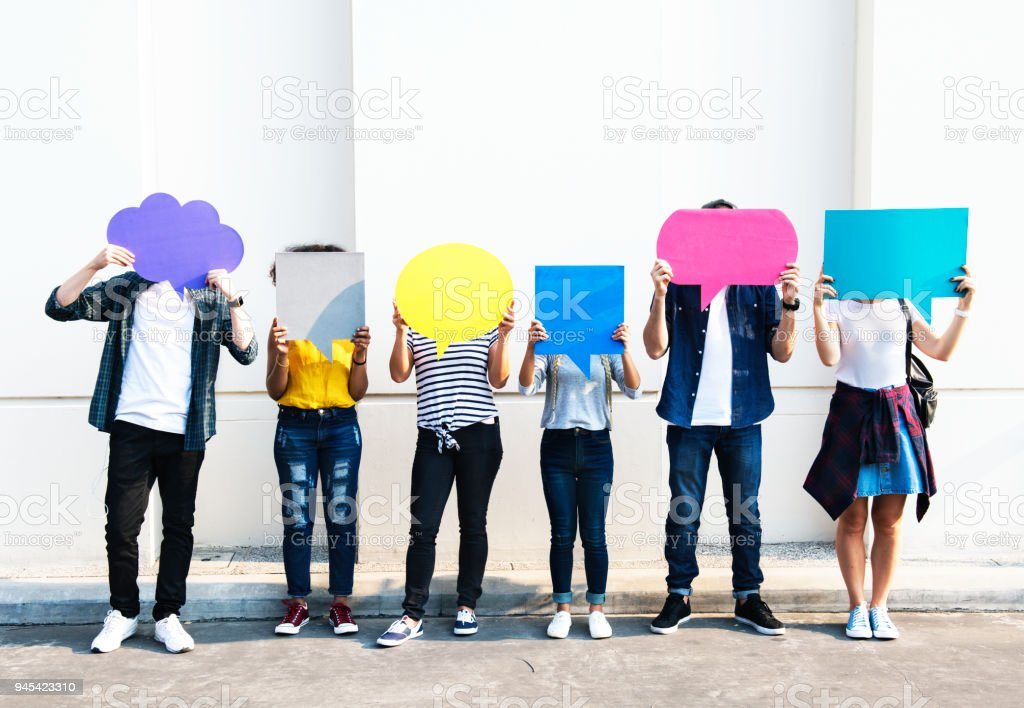 Young adult friends holding up copy space placard thought bubbles stock photo