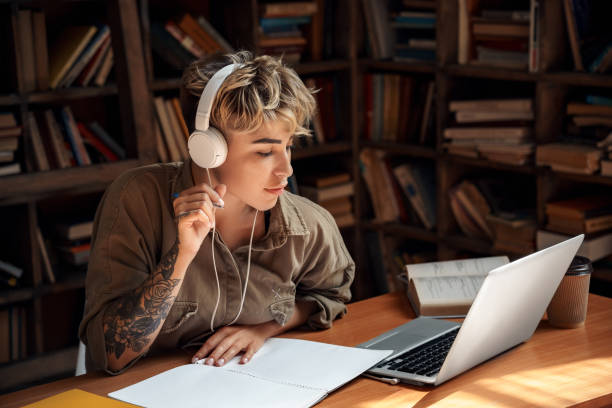 Young adult girl study at university library stock photo