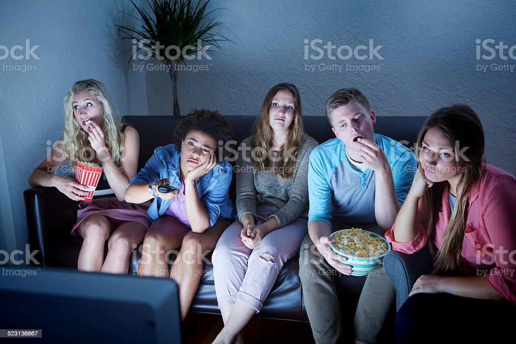 Young Adult Group Bored by TV Programing stock photo