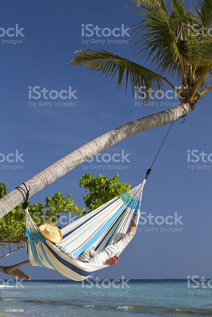Young adult having a nap in a hammock royalty-free stock photo