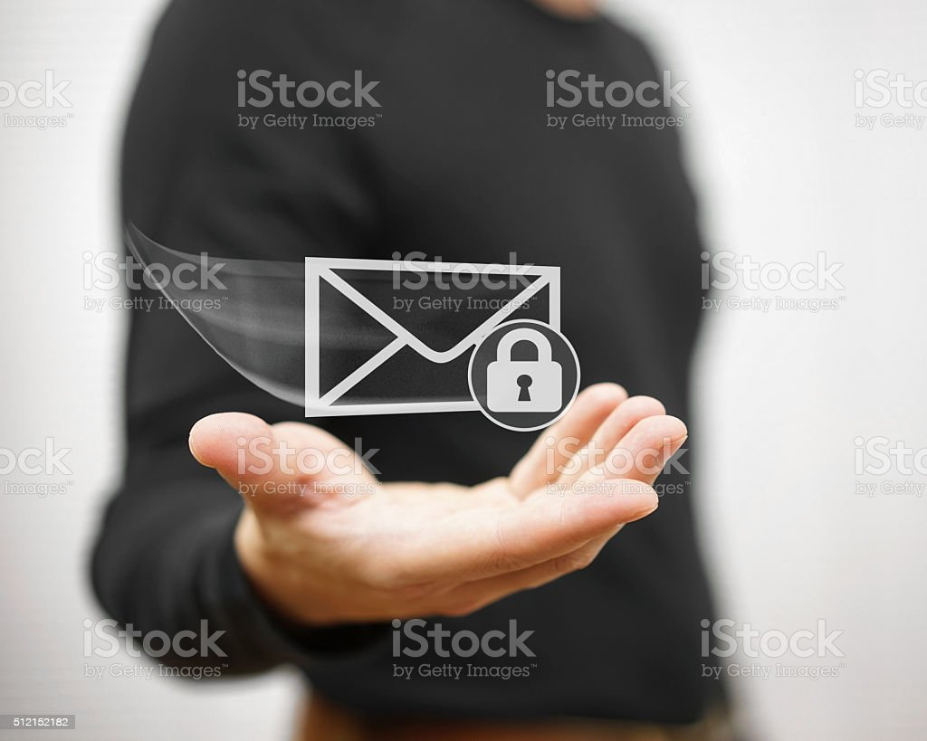 Young adult holding flying envelope witch padlock, secure communication concept stock photo