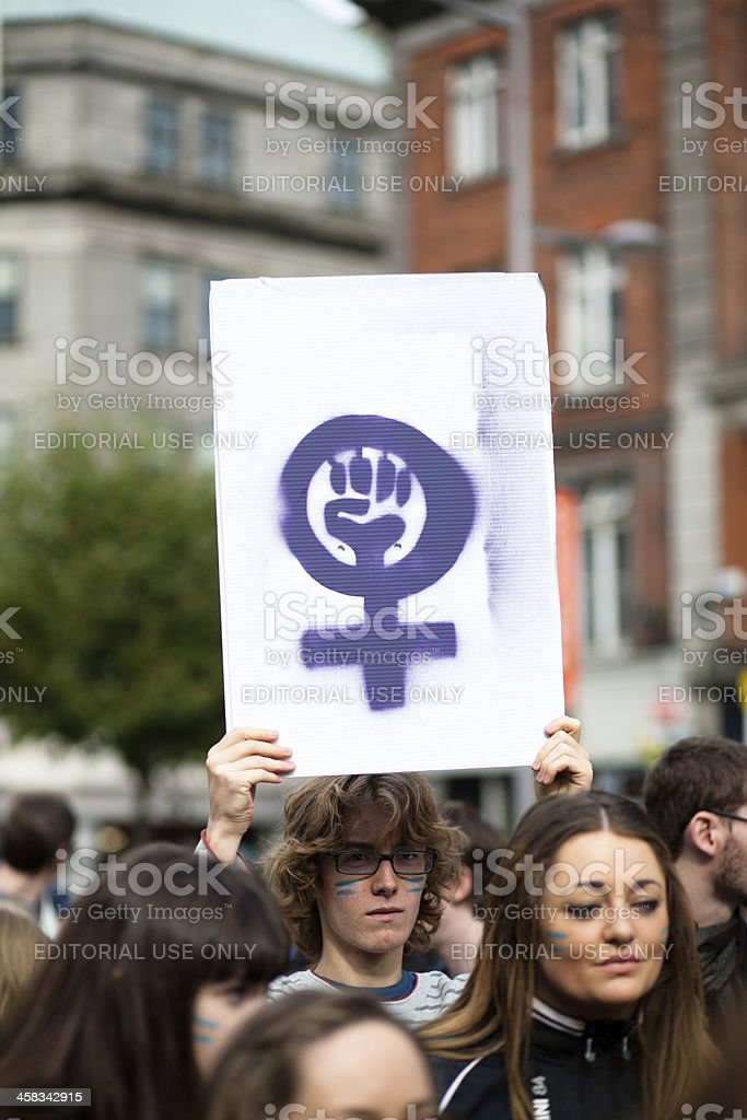 Young adult holding poster with pro-choice activists logo stock photo