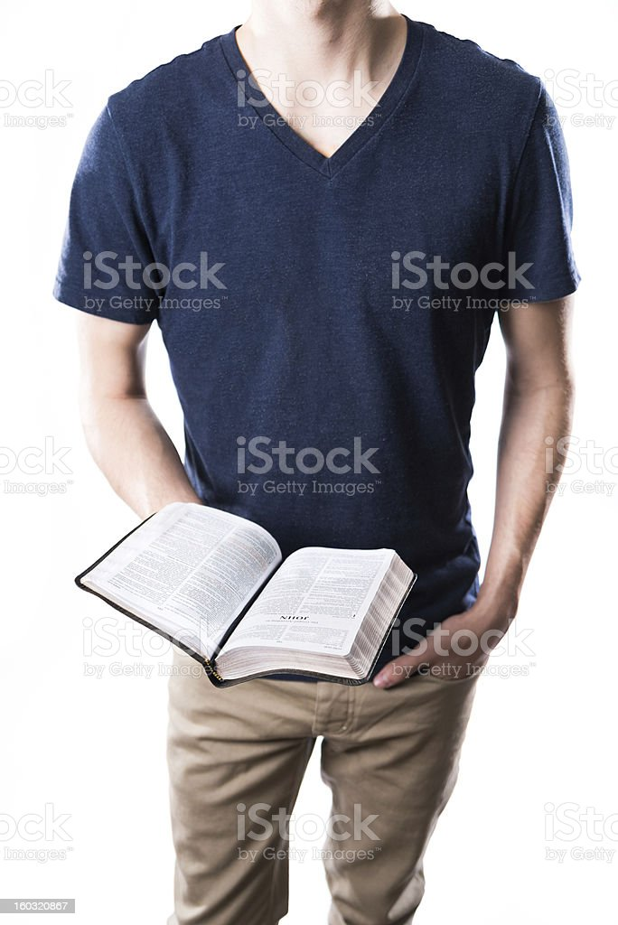 Young Adult Holding Religious Text royalty-free stock photo