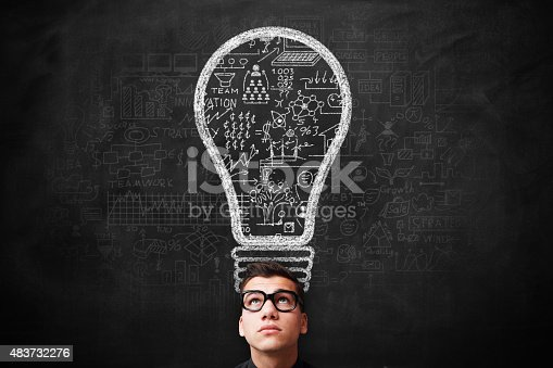istock Young adult Idea concept on blackboard 483732276