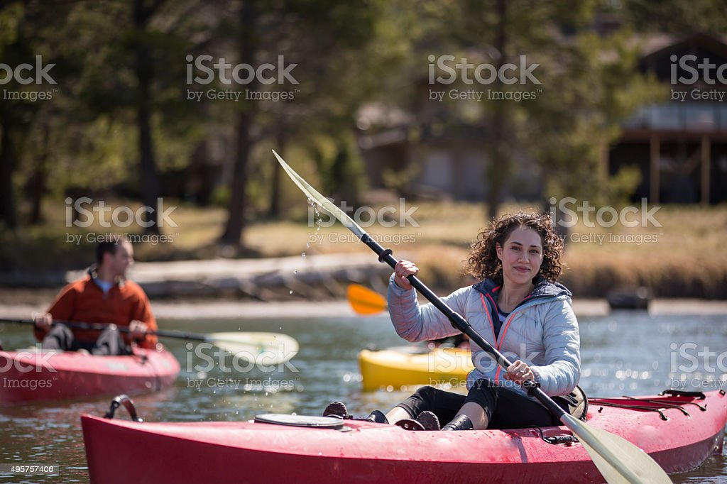 Young adult kayaking on river stock photo