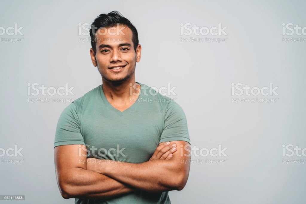 Young adult malaysian man portrait in studio stock photo