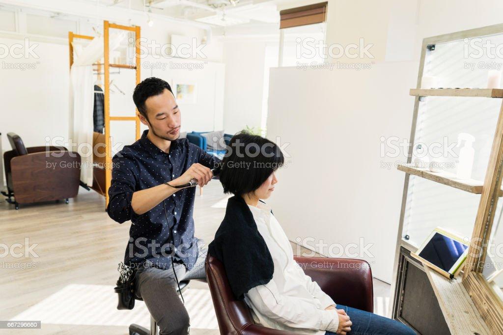 Mid adult woman at a hair salon