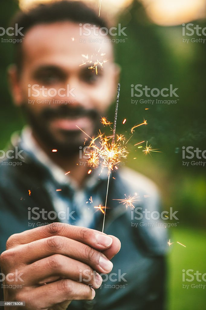 Young Adult Male Holding Sparklers stock photo