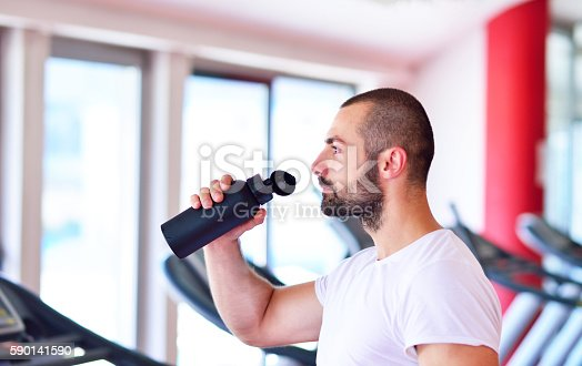 istock Young adult man drinking bottle of water 590141590