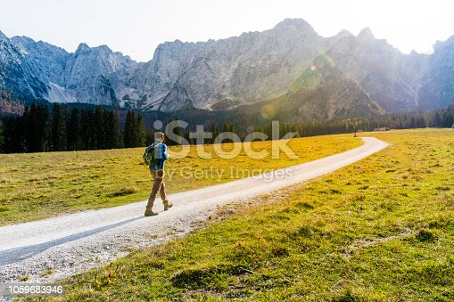 Young Adult Man Hiking In Autumn, Julian Alps, Lagi di Fusine Forest, Italy, Europe.
