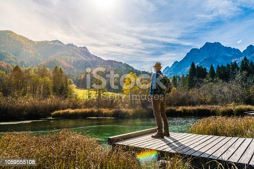 Young Adult Man Hiking In Autumn, Julian Alps, Kranjska Gora, Zelenci, Slovenia, Europe.