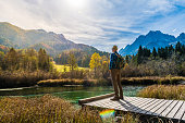 Young Adult Man Hiking In Autumn, Julian Alps, Kranjska Gora, Zelenci, Slovenia, Europe.