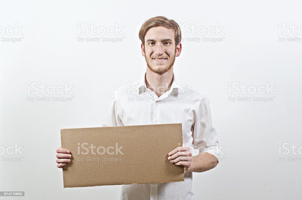 Young Adult Man Holding a Big Cardboard Inscription stock photo