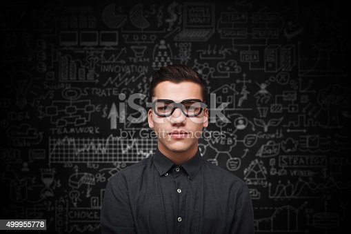 istock Young adult man on blackboard 499955778
