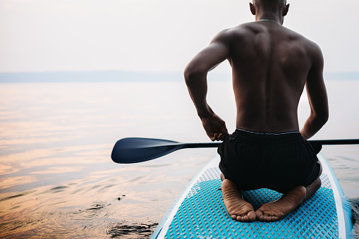 istock Young Adult Man Paddleboarding Puget Sound in Summer 1030930220