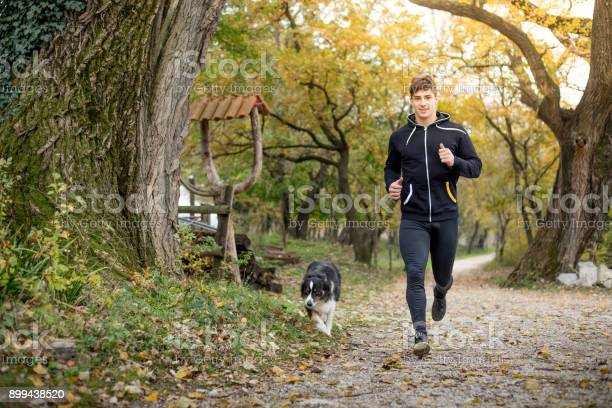 Young adult man running with his dog picture id899438520?b=1&k=6&m=899438520&s=612x612&h=plympikhjl3ylfk1k7jfsucrcneyfww5lvcqdfw6zba=