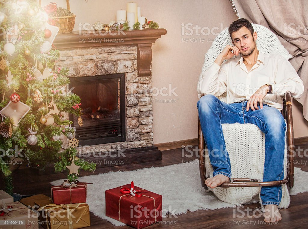 Excellent Young Adult Man Sitting In A Rocking Chair Stock Photo Pdpeps Interior Chair Design Pdpepsorg