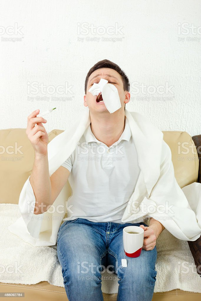 Young adult man suffering flu stock photo
