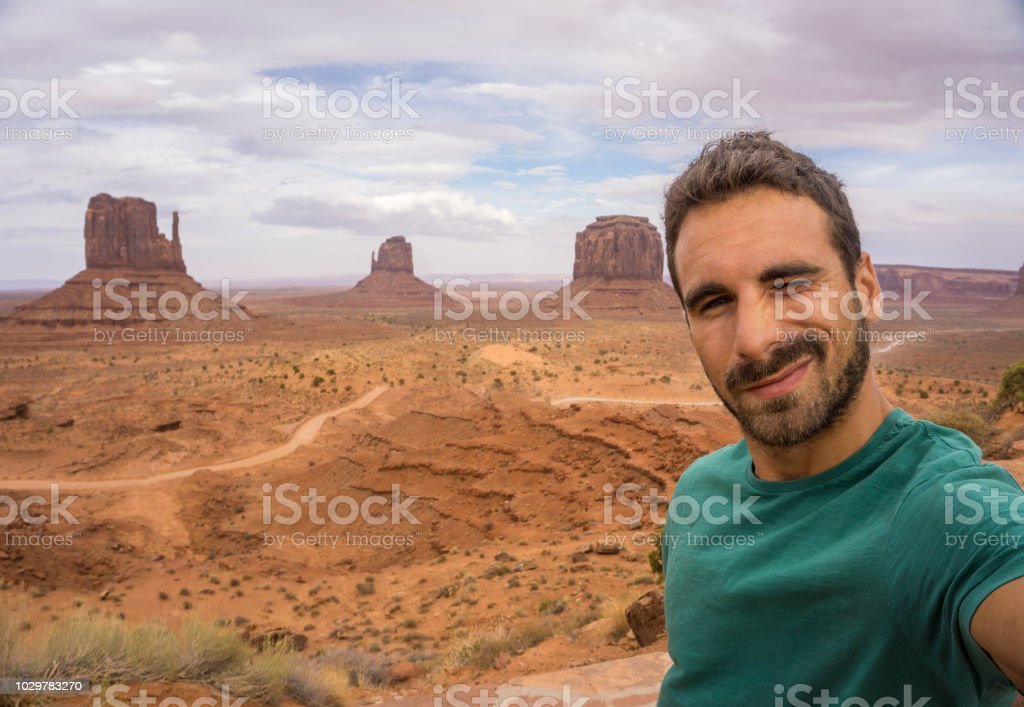 Young adult man taking a selfie in the Monument Valley stock photo