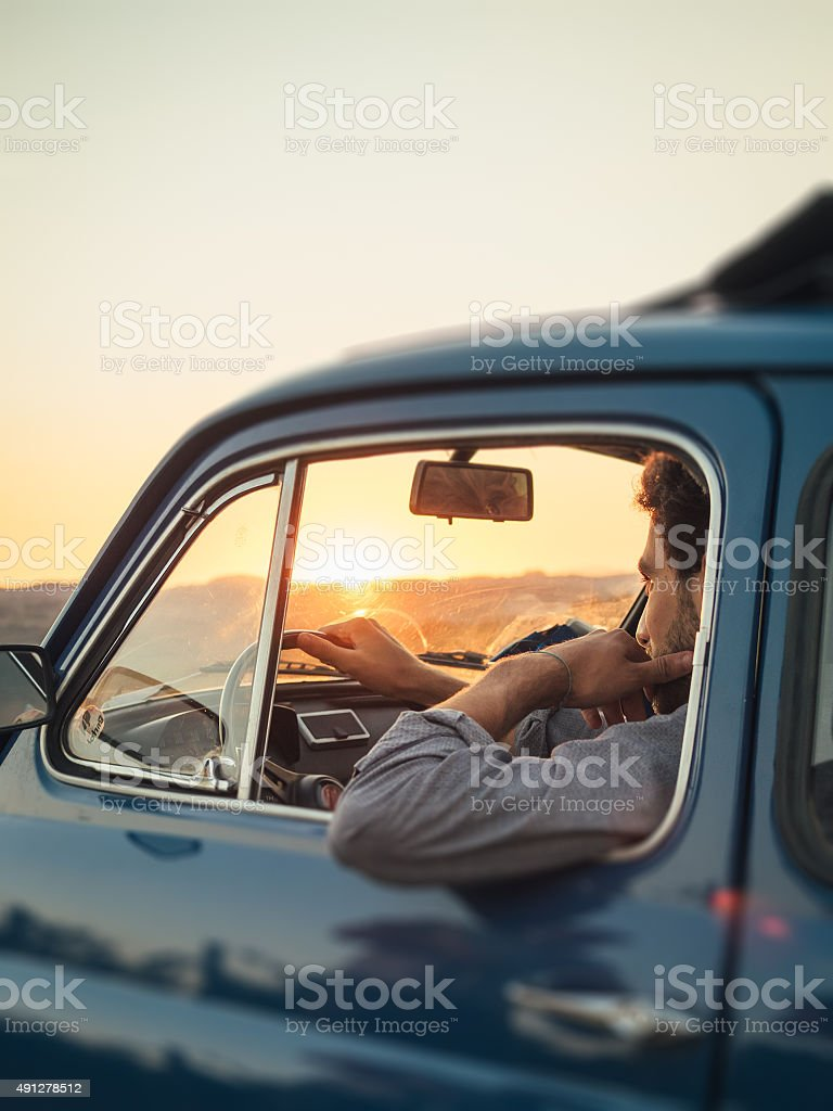 Young Adult Man Trip With Vintage Car stock photo