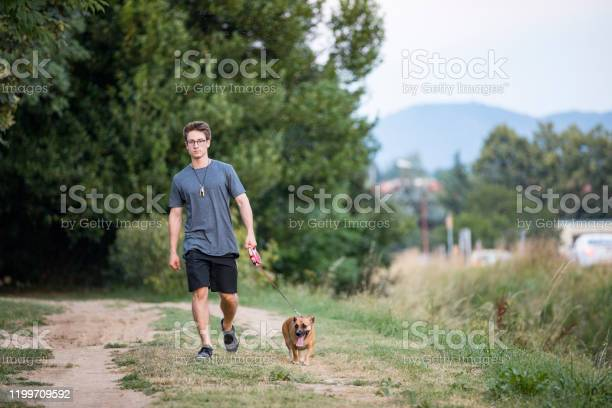 Young adult man walking his dog picture id1199709592?b=1&k=6&m=1199709592&s=612x612&h=ps2rjd34cg71 voa6qh57t52gevt7fsoefjmf7oxd48=