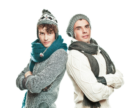 Young adult men in winter clothes