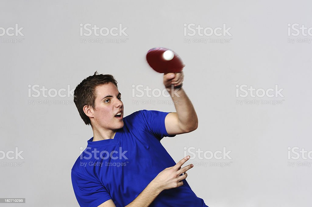 Young adult men playing table tennis royalty-free stock photo