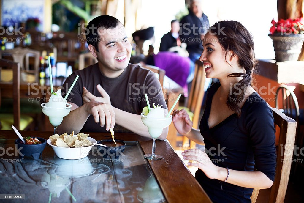 young adult Mexican couple dining royalty-free stock photo