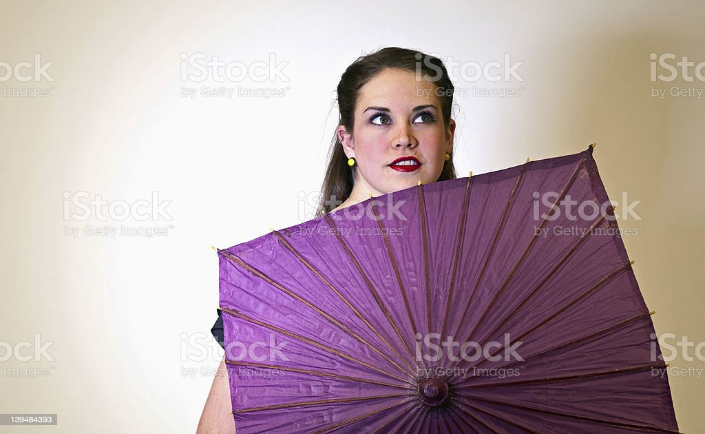 Young Adult Model Behind A Purple Parasol royalty-free stock photo