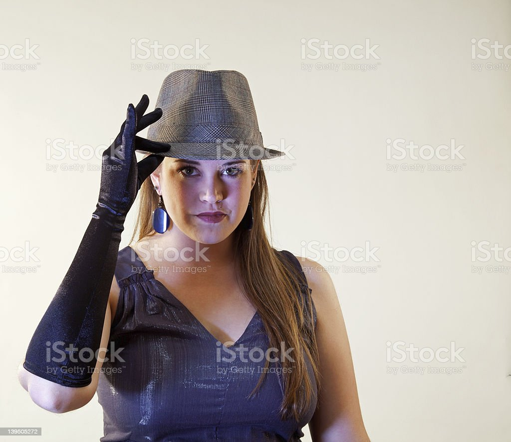 Young Adult Model Tipping Her Hat royalty-free stock photo