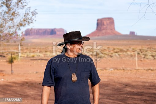 Young Adult Native American Navajo Man In His Home in Monument Valley Arizona