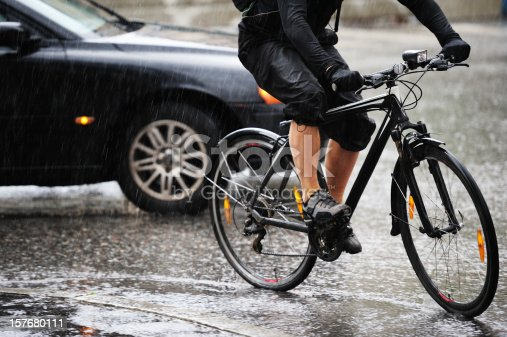 Man on a bicycle, a rainy day in Stockholm, Sweden