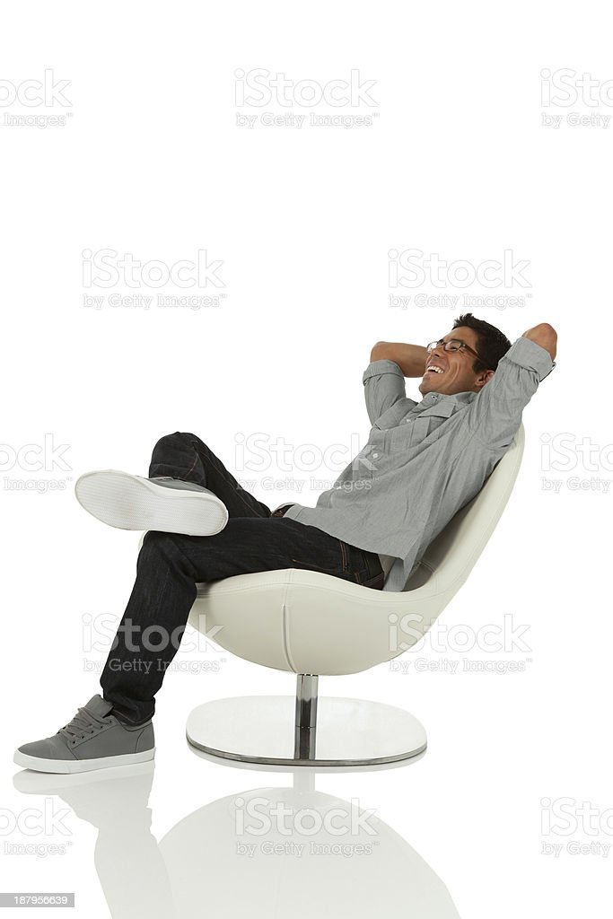 Swell Young Adult Relaxing On Chair Stock Photo Download Image Creativecarmelina Interior Chair Design Creativecarmelinacom