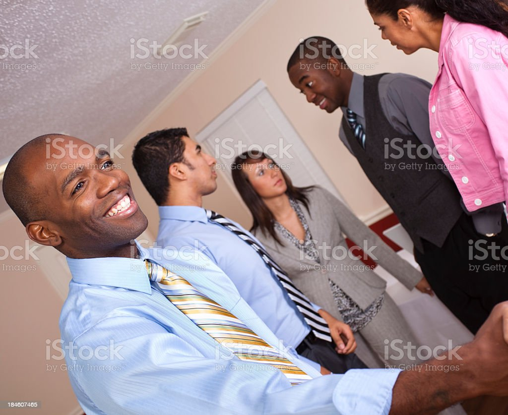 Young adult shaking hands at business meeting. royalty-free stock photo