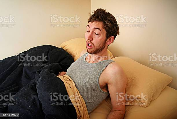 Young adult struggles to wake up in the morning picture id157305972?b=1&k=6&m=157305972&s=612x612&h=gtrew3jyygnno2bqxa uneyuyhe07bxdl1p6usivazy=