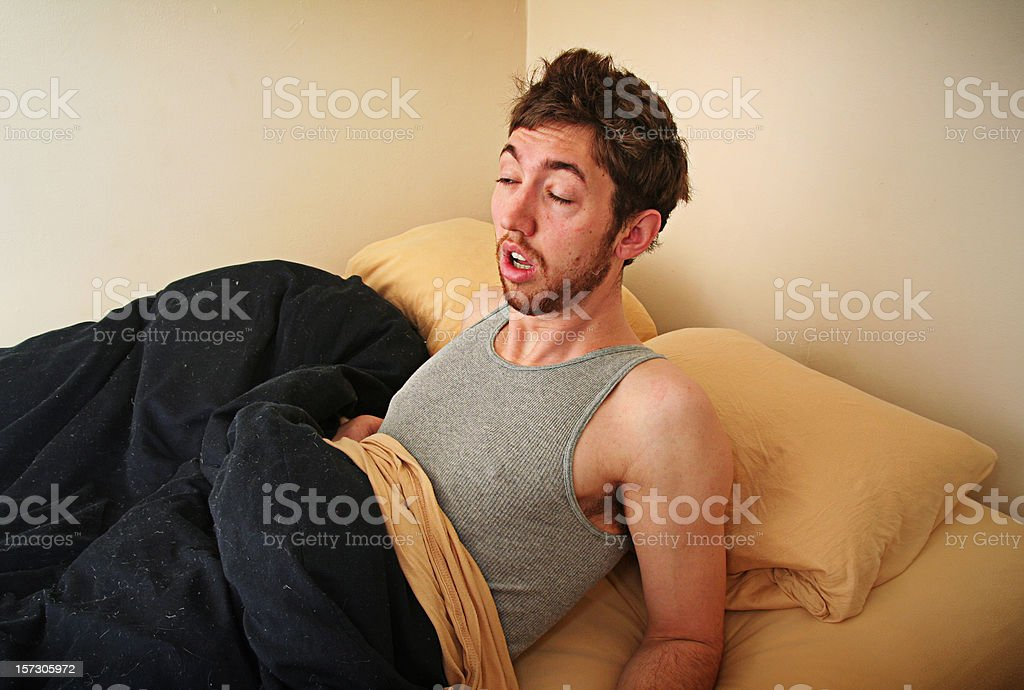 Young Adult Struggles to Wake Up In the Morning stock photo