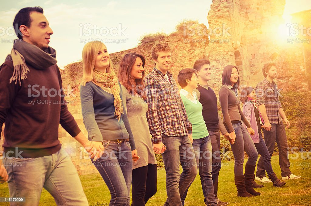 Young adult student outdoors holding hands royalty-free stock photo