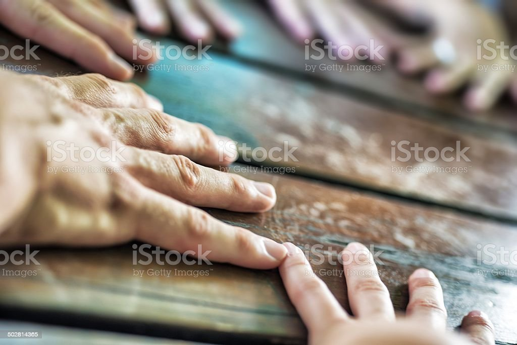Young Adult Team with Hands in Circle stock photo