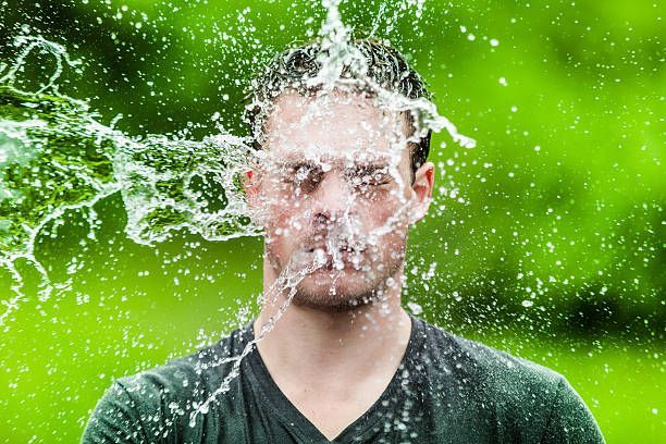 young adult that got completely drenched - drenched stock pictures, royalty-free photos & images