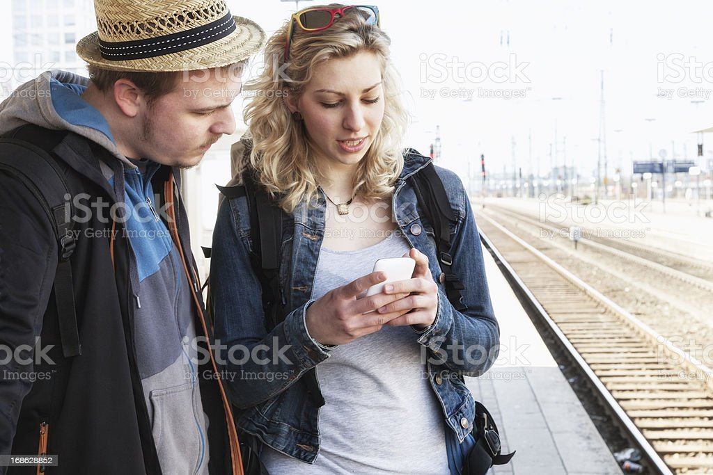 young adult traveling platform railway station smart phone royalty-free stock photo
