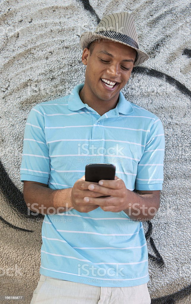 Young Adult using cellphone for text and chat. stock photo