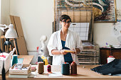 Young adult woman artist in her studio