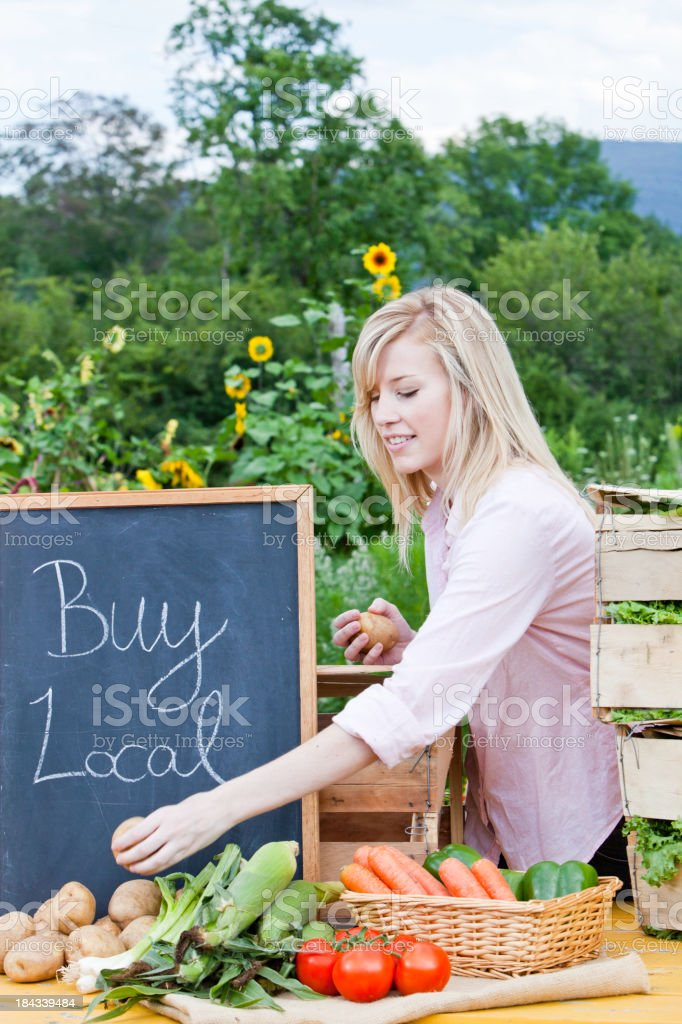 Young Adult Woman at Farmer's Market Vertical stock photo